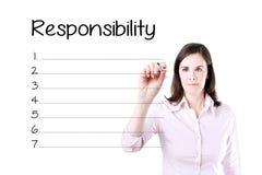 女商人文字在空白的责任名单 查出在白色 免版税库存照片