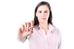 年轻女商人文字某事,在白色背景隔绝的屏幕上。 库存图片