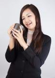 女商人是愉快喝咖啡 图库摄影