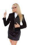 接触一个想象的屏幕的女商人。 免版税图库摄影