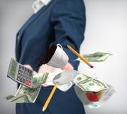女商人以盖帽投掷的美元 免版税图库摄影