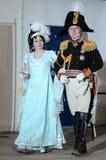 女士们先生们19世纪的舞厅衣服的在官员` s球 图库摄影