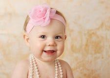 女婴俏丽微笑 库存图片