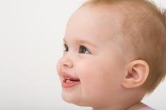 女婴微笑的小孩 免版税库存图片