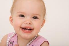女婴微笑的小孩 库存照片