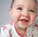 女婴微笑 免版税库存图片
