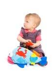 女婴查出演奏玩具 免版税库存图片