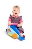 女婴查出演奏玩具 免版税图库摄影