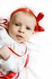 女婴红色丝带 库存图片
