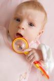 女婴藏品吵闹声 免版税库存照片