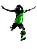 女子足球运动员被隔绝的剪影 免版税库存照片