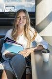 年轻女学生在学习区域 库存照片