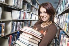 女学生藏品堆书 免版税库存图片
