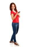 学生画象有电话的在手 库存照片