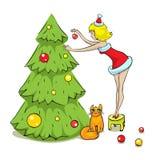 女孩、猫和圣诞树 免版税库存照片
