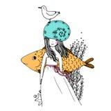 女孩、鱼、海鸥、海草、海星和圆环 库存照片