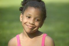 女孩一点俏丽微笑 免版税库存照片