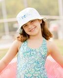 女孩一点准备好的游泳 免版税库存照片