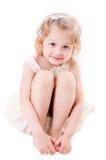 女孩一点坐的兴高采烈的白色 库存图片