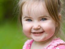 女孩一点微笑 图库摄影