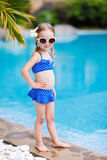 女孩一点最近的池游泳 库存照片