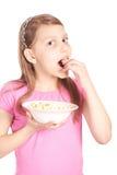 女孩一点玉米花纵向白色 库存图片