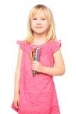 女孩一点铅笔微笑 免版税图库摄影