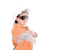 女孩一顶安全帽的建筑工人和 免版税库存照片