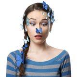 女孩与蝴蝶的艺术构成 免版税图库摄影