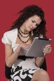 女孩个人计算机片剂 图库摄影