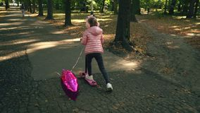 女孩乘坐滑行车 影视素材
