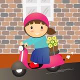 女孩乘驾摩托车滑行车 免版税库存图片