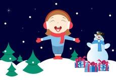女孩享用冬天雪 免版税库存图片