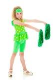 女孩以与大型机关炮的绿色。 免版税库存照片