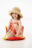 女孩仪器少许使用的玩具 免版税库存图片