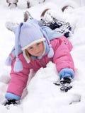 女孩位于的雪 免版税库存照片
