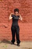 女孩体操做 免版税库存图片