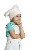 女孩佩带的厨师制服 图库摄影