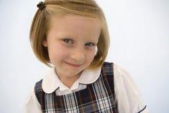 女孩佩带的校服 免版税库存图片