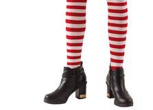 女孩佩带的stripey袜子和起动下半  免版税图库摄影