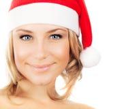 女孩俏丽的圣诞老人 免版税库存图片