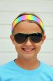 女孩俏丽的太阳镜 免版税库存照片