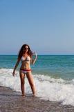 女孩俏丽的海滨 库存图片