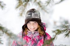 女孩俏丽的雪 免版税库存照片