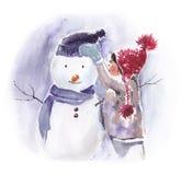 女孩做一个雪人 免版税库存照片