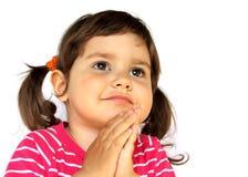 女孩做祈祷的愿望的一点 库存图片