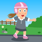 女孩公园直排轮式溜冰鞋 免版税图库摄影
