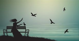 女孩剪影坐长凳在有日出的海附近和喂养海鸥,阴影,记忆, 库存照片