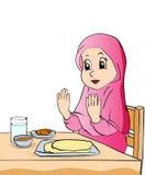 女孩动画片在吃传染媒介例证前祈祷 库存照片