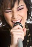 女孩卡拉OK演唱唱歌 库存图片